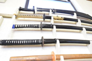 Swords and bokkens adorning the wall at Denton Academy of Martial Arts