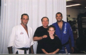 Eric Mattingly, Mr. Shoffit and Royce Gracie. Andrea Davis in front.